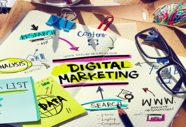 Colourful Desk with Tools and Notes About Digital Marketing