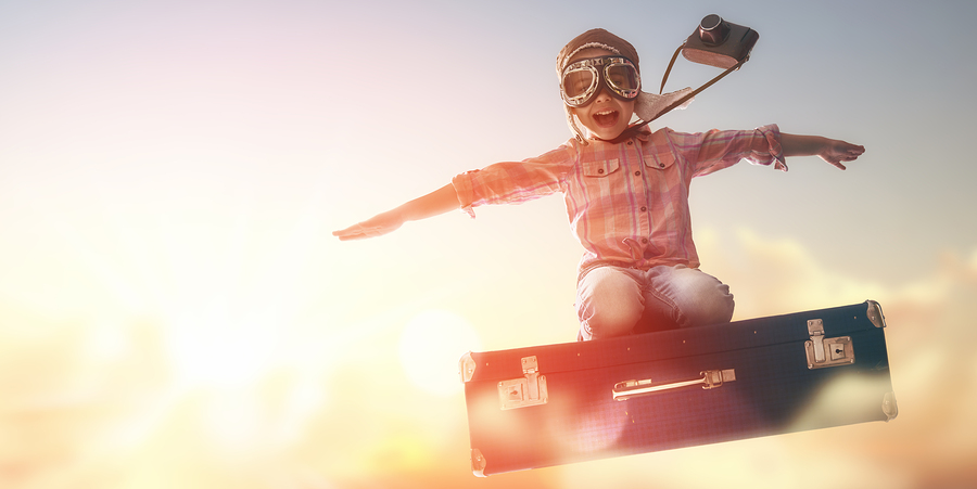 00-Child-Flying-on-a-Suitcase